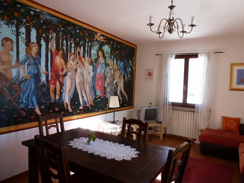 living room with mural of 'Primavera'