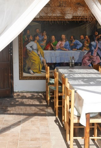outdoor dining area with picture of the 'Last Supper' in the background