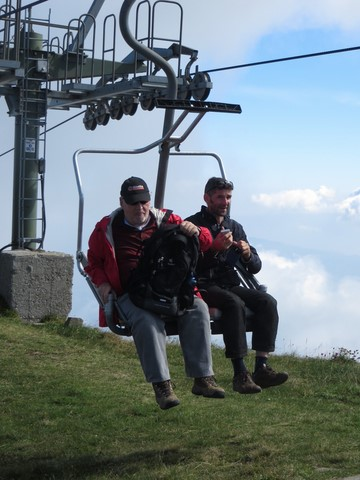 Two men ready to get off the chair lift