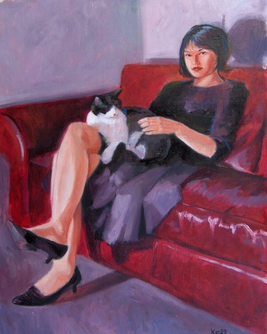 girl with cat on red sofa