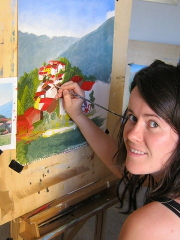 Girl painting a red roofed village