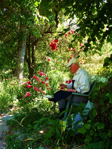 man painting in the garden